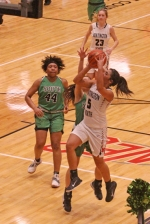 Peyton Dorsett (right), a senior on the Huntington North High School girls' varsity basketball team, fires a three-pointer in a game against visiting South Side on Tuesday, Jan. 22. Dorsett scored a team-high 14 points, but the Lady Vikings fell to the Lady Archers, 80-31.