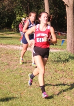 Kyler Hoopingarner, a senior on the Huntington North High School girls' cross country team, competes at the Northeast 8 Conference championship meet on Saturday, Sept. 29, at the Huntington University Cross Country Course. The Lady Vikings posted a score of 120 to place sixth.