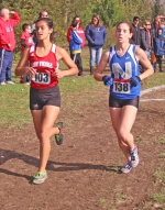 Huntington North senior Elizabeth Nalliah (left) runs alongside Brittany Bussard of Northfield during the latter stages of the Marion Girls' Sectional on Saturday, Oct. 13, at Indiana Wesleyan. Nalliah was the fifth finisher for HNHS and helped the Lady Vikings advance to next week's regional.
