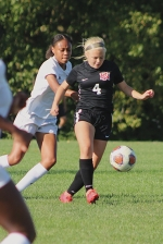 Gaining control of the ball over her opponent is Huntington North freshman Skylar Olson. The varsity Lady Vikings won 4-0 against visiting Snider on Tuesday, Aug. 18.