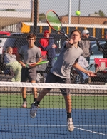 Huntington North's Matthew Weill puts a shot away at the net while No. 2 doubles partner Reid Eckert watches from the baseline in the championship of the Norwell Boys' Tennis Sectional on Saturday, Oct. 5. The Vikings won the title over the host school, 4-1.