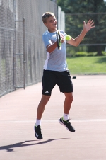 Swinging his racket to return the ball to his Peru opponent is Huntington North junior Jacob Daugherty. Daugherty competed in singles play against Ben Beckman of Peru at the Tuesday, Aug. 18, match.