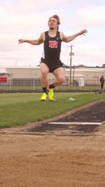Huntington North long jumper Ricky Haught tries to get as much air time as possible in the long jump at the Lime City Relays at Kriegbaum Field on Saturday, April 28. Haught finished fifth in the event with a jump of 20-9.75.