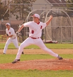 Austin Oswalt, a freshman on the Huntington North High School varsity baseball team, winds up for a pitch in a game against visiting Homestead on Tuesday, April 9. The Vikings lost, 17-2.