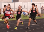 Ricky Haught (middle), a junior on the Huntington North High School boys' track team, takes the baton from teammate Deven Newcomb (right) as they compete in the 400-meter relay at the New Haven Sectional on Thursday, May 17. The Vikings finished fifth in the relay with a clocking of :45.92. As a team, Huntington North placed second at the meet with 96 points.
