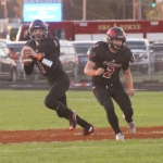 Huntington North High School quarterback Austin Spahr (left) looks for a receiver downfield while running back Mason Landrum keeps an eye out for attacking defenders in the Vikings' 42-12 loss to visiting Leo at Kriegbaum Field on Friday night, Sept.29.