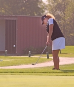 Huntington North golfer Danielle Gonser chips from just off the green at the third hole at Arbor Trace Golf Course in Marion on Saturday, Sept. 15, during play at the Eastbrook Girls' Golf Sectional. The Lady Vikings successfully defended the crown they won last year.