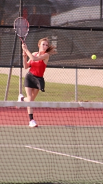 Jessica Henline, first singles player for the Huntington North High School girls' varsity tennis team, drives a backhand over the net in action on Tuesday, April 16. Henline and the Lady Vikes triumphed 5-0 to improve to 5-1 in the season.