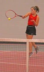 Crosley Stanley, a senior on the Huntington North High School girls' tennis team, lays a hit on the ball during her match at second doubles versus Bellmont on Tuesday, April 30, in the Huntington North Fieldhouse. Stanley and her teammate, Sydney Smekens, won the match, 7-6, 6-4, and the Lady Vikings beat the Lady Braves, 4-1.