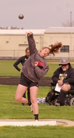 Lady Viking Isabel Niswander throws the shot put during the Lime City Relays on Saturday, April 27, at Kriegbaum Field.