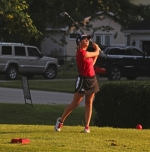Jaclyn Boyd, a senior on the Huntington North High School girls' varsity golf team, watches her tee shot on the third hole at Norwood Golf Course during the Huntington North Invitational on Wednesday, Aug. 2. Boyd shot an 88 to finish 10th individually and the Lady Vikings fired a 360 to place second as a team.
