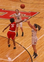 Huntington North's Reece Colclesser fires a jump shot over Nya Coleman of Fort Wayne North Side in action Friday night at North Arena. The Lady Vikes whipped the visitors, 55-31.