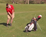 Graham Scher, a junior on the Huntington North High School boys' varsity golf team, chips the ball on the second hole of Norwood Golf Course, in Huntington, during a match against Northfield on Tuesday, April 9. The Vikings won, 177-202.