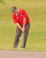 Graham Scher, a junior on the Huntington North High School boys' golf team, hits a chip shot at Rozella Ford Golf Club, in Warsaw, during the Warsaw Sectional on Friday, May 31. Scher fired an 83 to lead the Vikings, who placed eighth as a team with a score of 353.