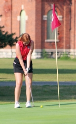 Positioning herself to putt her ball into hole nine on Tuesday, Aug. 25, is Huntington North High School golfer Kassidy Krumanaker. Krumanaker shot a 50 against her Bellmont opponent during the Tuesday evening match at Clear Creek Golf Course.