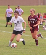 Huntington North soccer player Hannah Tillett maneuvers with the ball past Margo Keller of Columbia City during action Tuesday, Aug. 30, at HNHS. Tillett pumped in three goals and had two assists as the Lady Vikings won, 7-0.