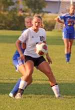 Huntington North's Karmen Koch maneuvers with the ball despite the efforts of a visiting Homestead defender in the Lady Vikes' 4-0 win on Thursday, Sept. 21. Koch scored a hat trick to lead the win.