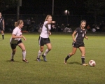 Huntington North freshman Addy Wiley (second from left) directs the defense while teammate Elaina Teusch runs alongside her during sectional action against host Warsaw on Thursday evening, Sept. 4. The Lady Vikes lost, 6-1.