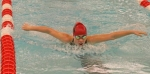 Crosley Stanley, a junior on the Huntington North High School girls' swim team, competes in the 100-yard butterfly in the preliminaries of the Warsaw Sectional on Thursday, Feb. 1.