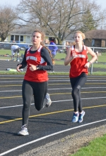 Huntington North runners Hollyn Anderson (left) and Lesley Zook run 1-2 in the 1,600-meter run on Wednesday, April 18, against visiting New Haven. The pair finished first and second, respectively, as HNHS crushed the Lady Bulldogs, 96-32.