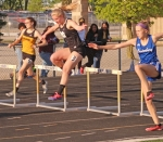 Allie Aschliman (second from left), a junior on the Huntington North High School girls' track team, lands as she competes in the 300-meter hurdles at the New Haven Sectional on Tuesday, May 14. Aschliman placed ninth in :53.46 for Huntington North, which finished second at the meet.