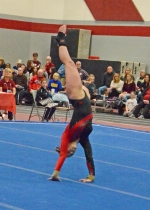 Huntington North junior Aleah Eckert is in the middle of a tumbllng run in floor exercise at the Huntington North Regional Gymnastics Tournament on Saturday, March 2. Eckert placed 11th to end her season.