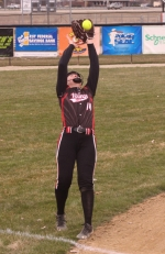 Macy Lange, a junior on the Huntington North High School varsity softball team, catches a pop-up in the Lady Vikings' season opener against visiting Northrop on Tuesday, April 10. Huntington North won big, 15-5.