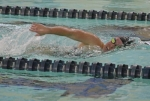 Allie Aschliman, a senior on the Huntington North High School girls' swim team, takes a breath as she competes in the 200-yard individual medley during a meet against visiting Canterbury on Tuesday, Nov. 26. The Lady Vikings won the meet, 92-68.