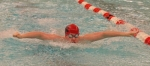 Huntington North freshman Cole Davidson competes Friday night in the 100-yard butterfly at the Warsaw Boys' Swim Sectional.