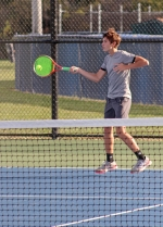 Reid Eckert, one-half of the Huntington North High School No. 2 doubles team, plays a forehand in the Vikings' sectional semifinal match against Bluffton on Friday, Oct. 4. Eckert and his partner, Matthew Weill, won their match as the Vikings won, 4-1, to advance to the sectional finals.