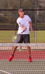 Spencer Atkinson, a senior on the Huntington North High School boys' varsity tennis team, lays a hit on the ball in action at second doubles during a match against visiting Norwell on Tuesday, Sept. 18. Atkinson and partner Noah Zahn won their match, 6-0, 6-2, to help the Vikings beat the Knights, 4-1.