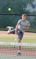 Huntington North's second singles player, Thomas Schweller, serves during his 6-1, 6-0 win over Trey Williams of Warsaw on Wednesday, Aug. 21, at HNHS. The Vikings fell, 2-3.