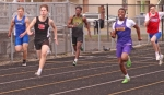 Huntington North High School runner Jackson Holzinger (second from left) competes in the 200-meter dash preliminaries on Saturday morning, May 11, at Kriegbaum Field at the Huntington North 9th & 10th Invitational.