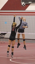 Morgan Robrock gets ready to slam a spike in action against Prairie Heights at the Huntington North Varsity Volleyball Invitational on Saturday, Aug. 25.