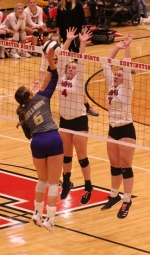 Maddy Levy (middle) and Mia Garner (right), seniors on the Huntington North High School volleyball team, go up together for a block during a match against New Haven in the quarterfinals of the Huntington North Sectional on Thursday, Oct. 17. The Lady Vikings' season came to an end with a 1-3 defeat.