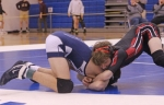 Huntington North 113-pound wrestler Brady Lewis locks up with a foe at the Carroll Regional Wrestling Tournament on Saturday, Feb. 8. Lewis finished fourth in his weight class to advance to next week's New Haven Semi-State