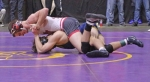 Huntington North High School senior Darryn Kuhl is on top of Payne Blackburn of Delta in their first-round match at 126 pounds at the New Haven Wrestling Semi-state on Saturday, Feb. 15. Blackburn went on to win and ended Kuhl's season at 29-5.