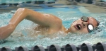Henry Landrigan, a Huntington North High School varsity swimmer, competes during a home meet on Tuesday, Jan. 19. HNHS hosted the Norwell Knights during the Jan. 19 meet, falling short to their guests.