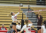 Reaching up to return the ball to their Columbia City High School opponents on Thursday, Sept. 17, is Huntington North High School varsity volleyball player Emma Holzinger. HNHS fell to the Columbia City Eagles in five matches that evening.