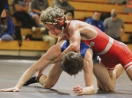 The Huntington North High School wrestling teams hosted Carroll High School on Wednesday, Jan. 13. Featured above, HN senior Matthew Kline competes against Ethan Fitch.