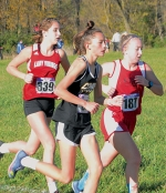 Elle McDonald  (left), a Huntington North High School cross-country runner, participates in the Semi-State cross country competition, held on Saturday, Oct. 24. The competition was hosted by New Haven and held at Huntington University's Cross Country course.