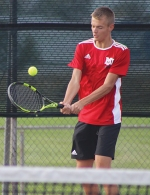 Competing against Northrop's Josiah Schmucker in singles play on Wednesday, Sept. 23, is Huntington North High School varsity tennis player Noah Zahn. Zahn ended his evening with two 6-0 sets.