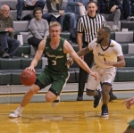 Huntington University guard Konner Platt heads toward the basket in action against East-West University on Friday night in the opening round of the Ness Bros. Hall of Fame Tournament at Platt Arena. The Foresters ran past the visitors, 89-51.