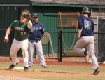 Huntington University first baseman Shea Beauchamp gloves a throw to retire Brant Miller of Mount Vernon Nazarene University in first-game action at Forest Glen Park on Tuesday, March 21. HU split a twinbill with the Cougars, winning the first game, 6-0, but losing the second, 7-5.