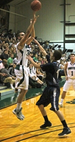 Huntington University's TJ Short (left) fires a shot from beyond the arc with a defender from visiting Ohio State University Mansfield in his face during the Foresters' game against the Mavericks on Saturday, Nov. 16.