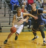 Huntington University's Derek Hinen (left) zips by a defender from visiting Marian University in the first half of a men's basketball game on Saturday, Jan. 30. Hinen scored a game-high 27 points and the Foresters won, 88-79.