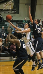Huntington University sophomore guard Kyle Pipenger finds a way to the hoop past and over Grace Bible College defenders on Saturday, Dec. 20, in the Foresters' 78-66 win.