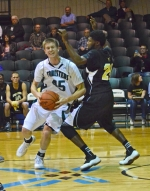 Huntington University freshman Daniel Woll maneuvers in the lane against visiting Purdue North Central on Tuesday, Nov. 5.