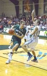 Huntington University freshman Daniel Woll makes a move to the basket during the Foresters' 85-51 win over Great Lakes Christian College on Friday night, Nov. 8, at the Ness Bros. Hall of Fame Classic at HU.