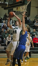 Huntington University forward Austin Clark gets inside for a tough shot against the University of Saint Francis on Tuesday, Feb. 17, at Platt Arena. The Foresters lost to the No. 8 Cougars, 94-81.